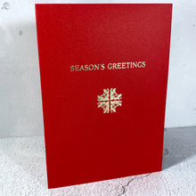 Load image into Gallery viewer, 5 pack of Christmas cards. Traditional hot foil letterpress printed with Season's Greetings and a snowflake/cross design made from rearranged corner ornaments featuring holly and bells.