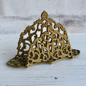 Ornate brass letter rack.