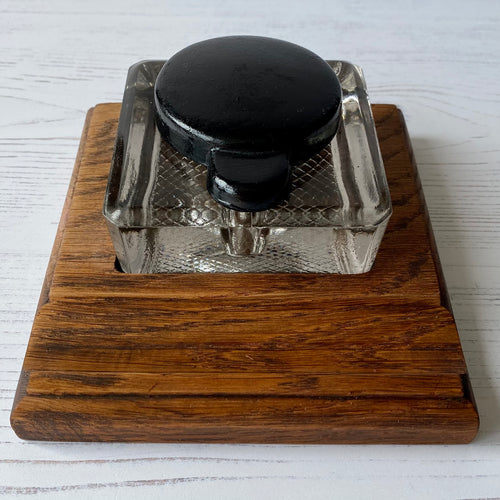 Inkwell.  Square glass inkwell on wooden stand base.  1930s/40s ?