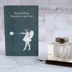 Fairy card and glass inkwell.