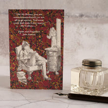 Load image into Gallery viewer, Pride and Prejudice quotation on red background card with glass inkwell and dip pen.