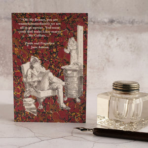 Pride and Prejudice quotation on red background card with glass inkwell and dip pen.