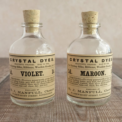 Small penny dye bottle featuring an original Victorian label