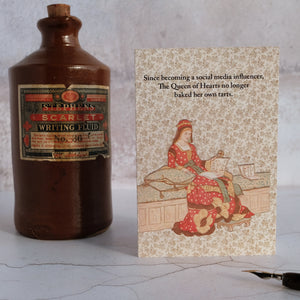 Stone writing fluid bottle with The Queen of Hearts card.