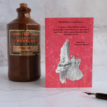 Load image into Gallery viewer, Jane Eyre quotation card beside a stone ink bottle.