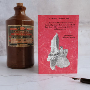 Jane Eyre quotation card beside a stone ink bottle.