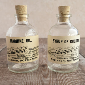 Small apothecary bottle featuring an original vintage label with a beautiful script design (Claud Manfull options)