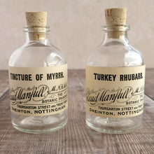 Load image into Gallery viewer, Small apothecary bottle featuring an original vintage label with a beautiful script design (Claud Manfull options)