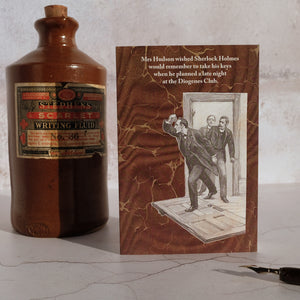 Stone ink bottle and Sherlock Holmes card.