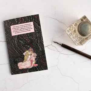 Card beside glass inkwell and dip pen. Book collector humour.