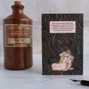 Card beside stone ink bottle with dip pen.