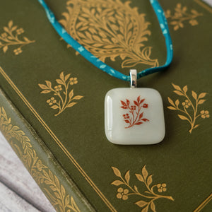 SALE Glass pendant featuring a vintage book design on Liberty print fabric cord