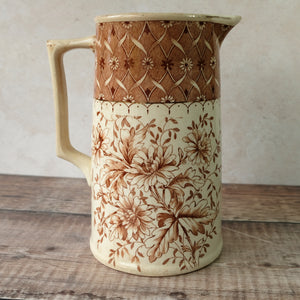Large vintage jug with chrysanthemum design in neutural brown and cream