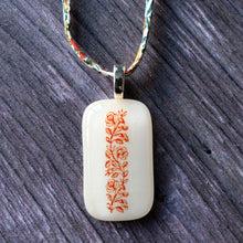 Load image into Gallery viewer, SALE Glass pendant featuring vintage book ornament designs on Liberty print fabric cord