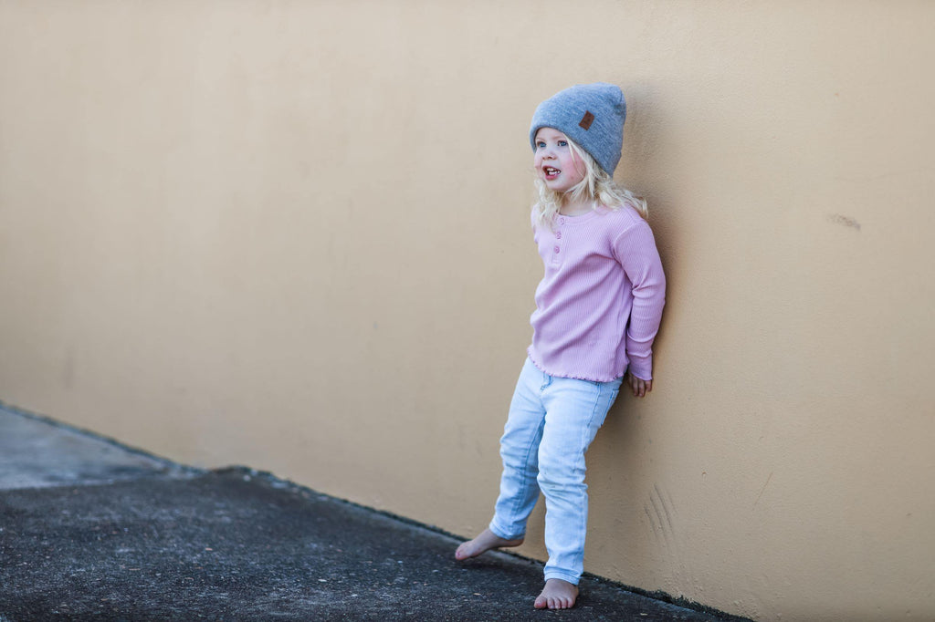 Kid wearing grey winter beanie. Cubs and Co. Australia