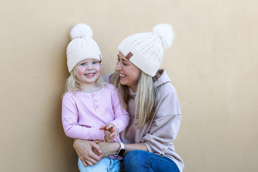 Matching mum and daughter cream winter cotton beanie with pom pom. Cubs & Co. Australia.