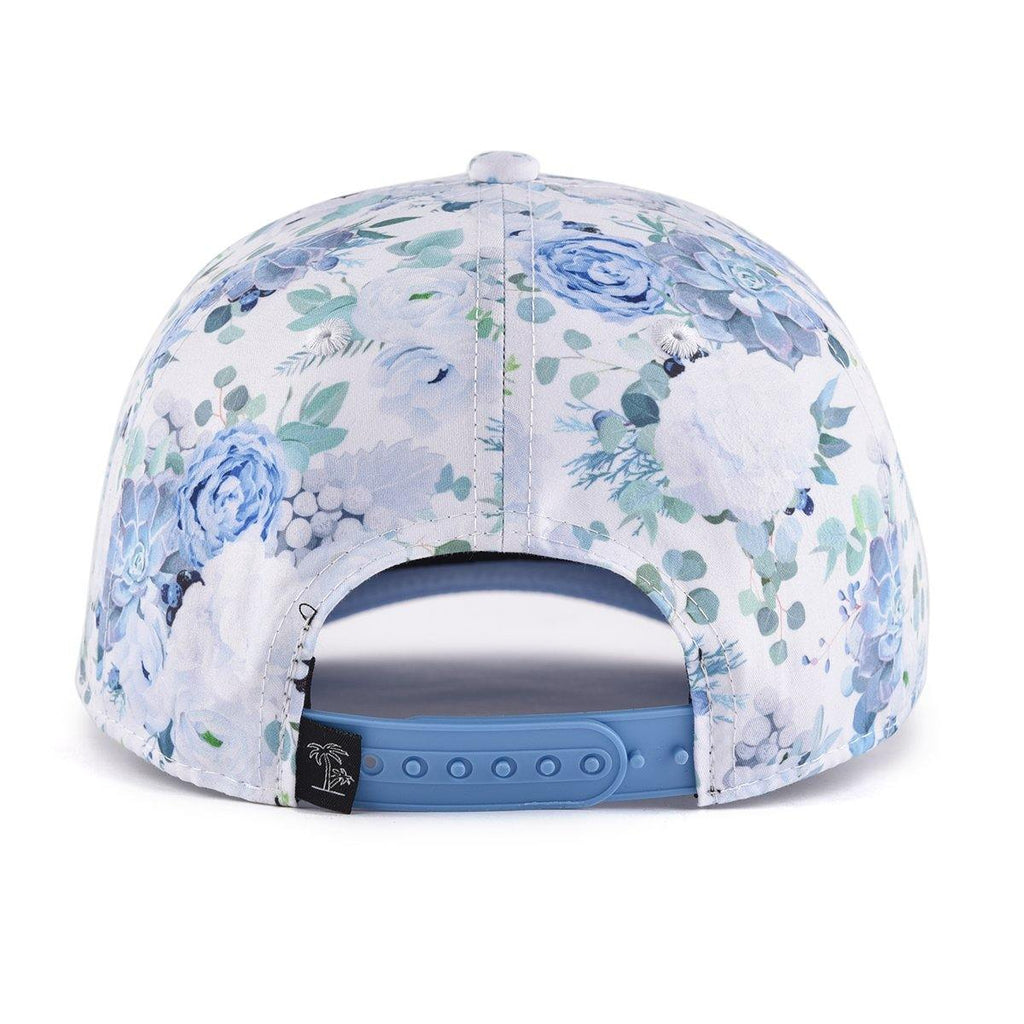 Kids and women's blue floral baseball snapback cap. Cubs & Co. Australia.
