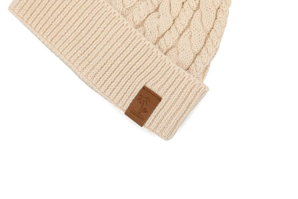 Cream winter cotton beanie with pom pom for kids, women and men. Cubs & Co. Australia.