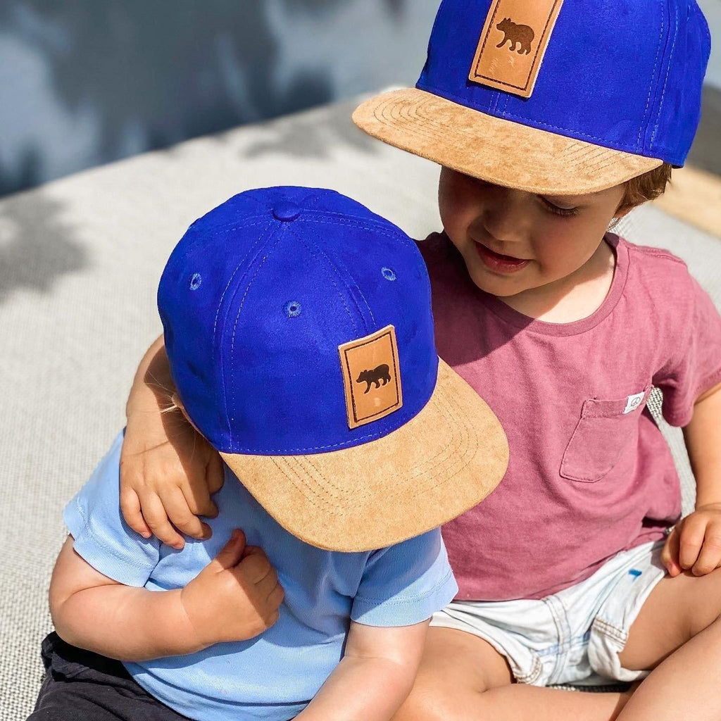 Boys wearing matching suede snapback hats. Cubs & co. Australia