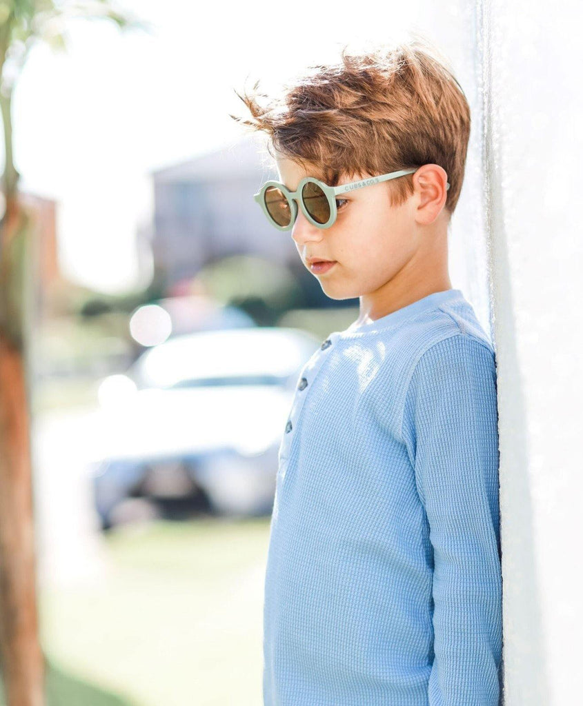 Boy wearing kids green olive sunglasses with UV protection. Cubs & Co. Australia