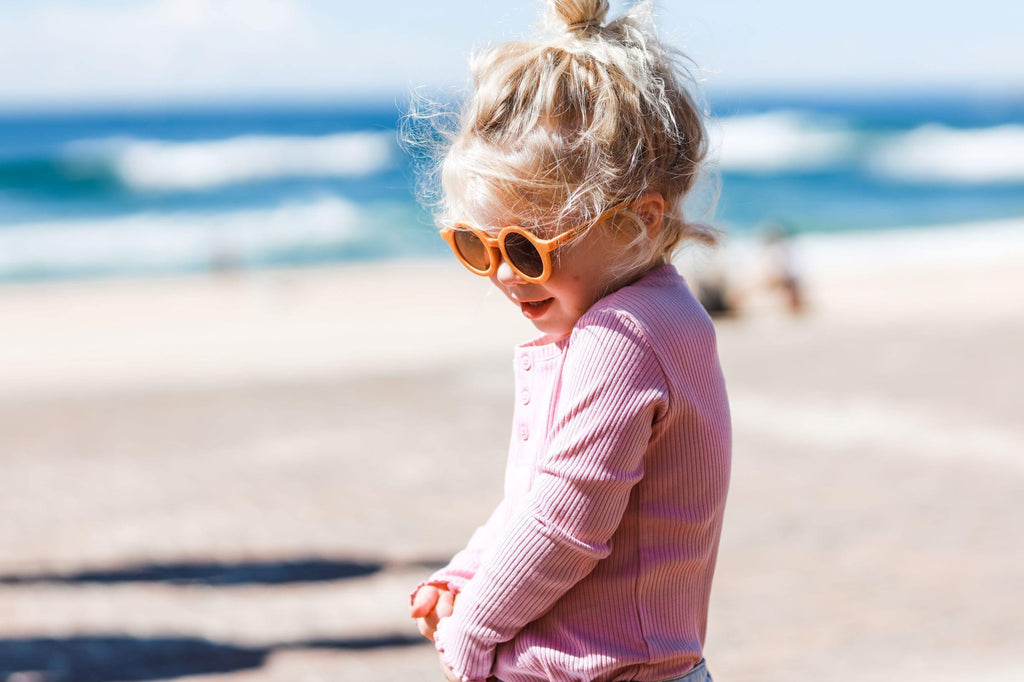 Girl wearing kids yellow butterscotch sunglasses with UV protection. Cubs & Co. Australia