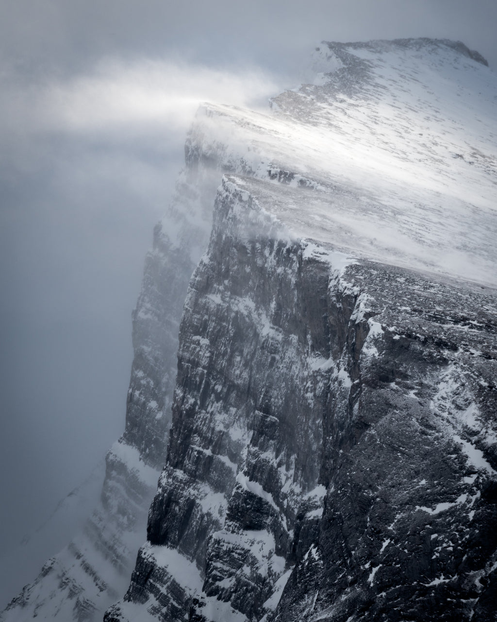 Snow sweeps off summit of Mount Rundle, Banff National Park, monochrome landscape photography