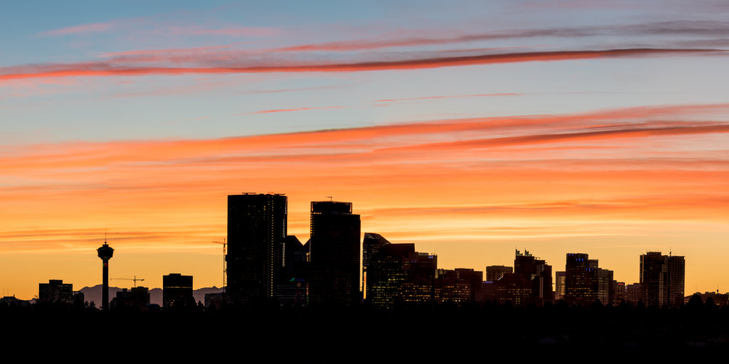 Calgary skyline silhouetted by colourful sunset