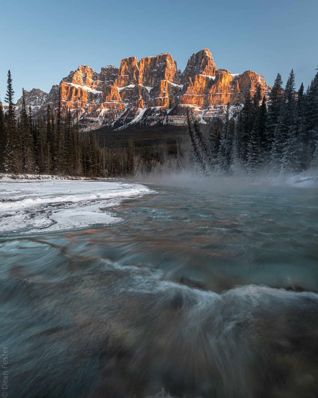 Castle mountain and Bow River at sunrise in Banff National Park, Alberta