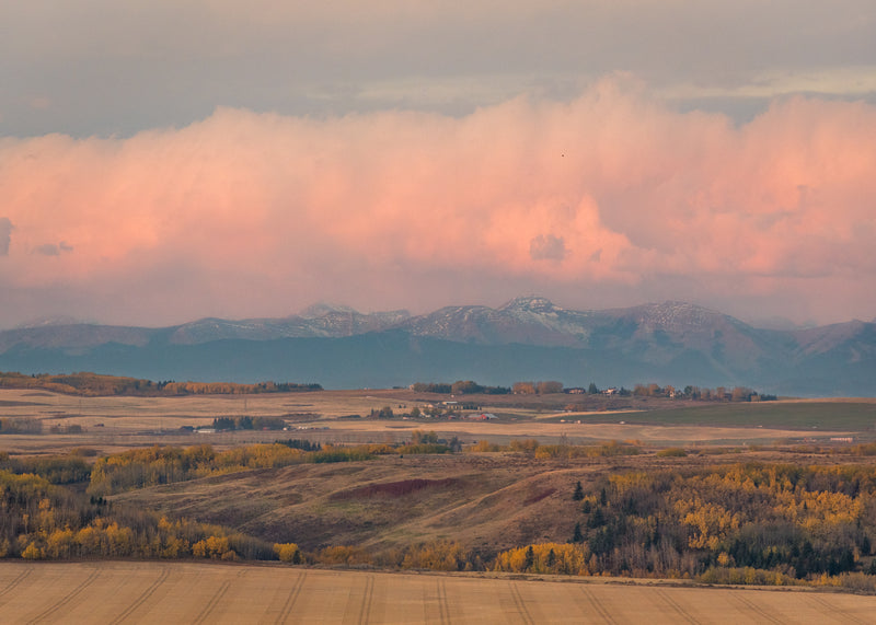 Glenbow Ranch Provincial Park viewpoint of foothills and rocky mountains at sunrise