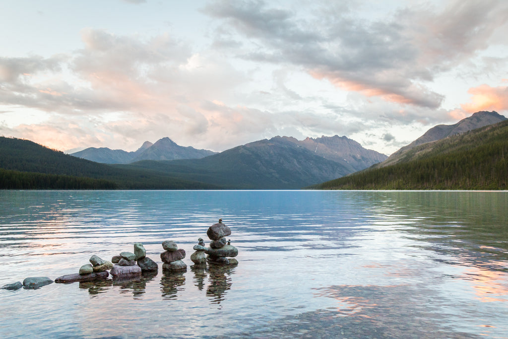 Rock piles in Kintla Lake at Sunset, Rocky Mountains, Glacier National Park Montana, Landscape Photography
