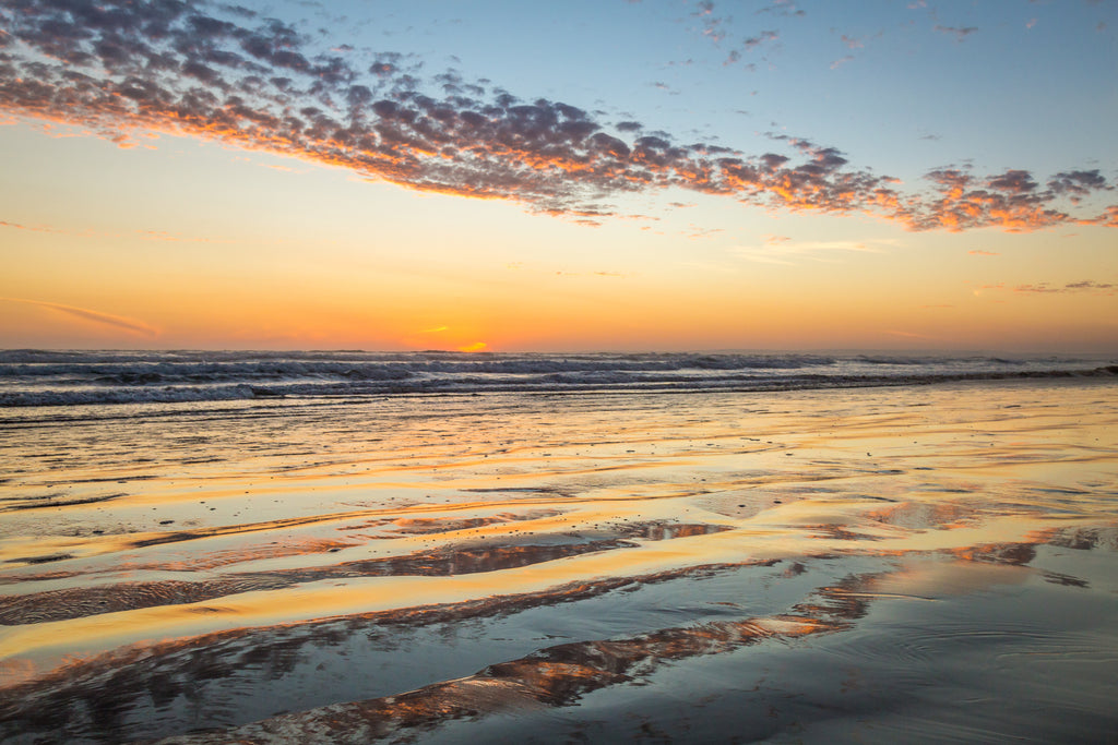 Beach sunset reflecting in ocean, Goolwa Australia, landscape photography