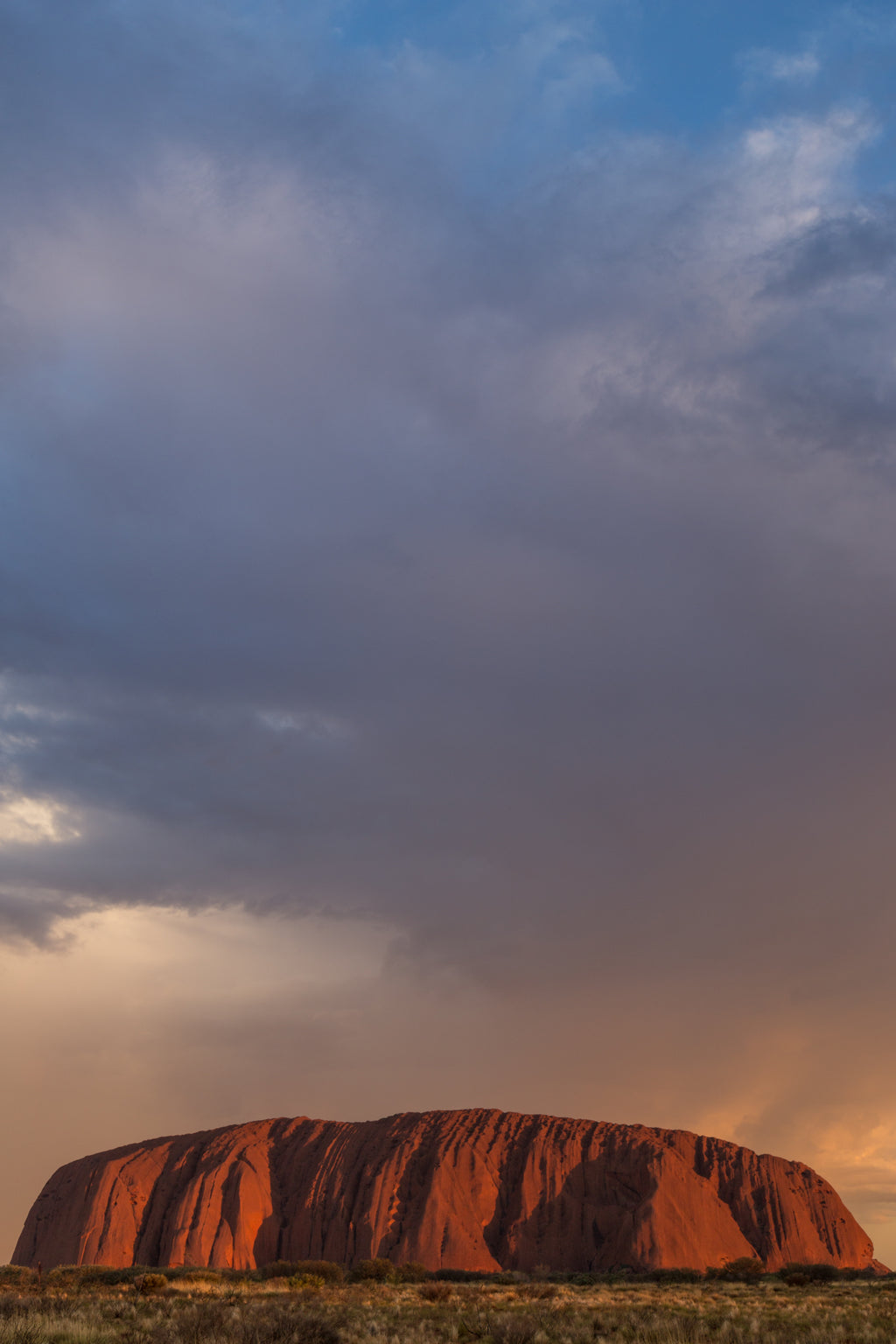 Storm clouds pass over Uluru (Ayers Rock) at sunset, Australian Outback, travel landscape photography