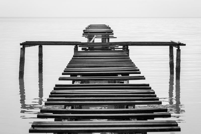 Old pier falling apart, black and white photography, parallel lines
