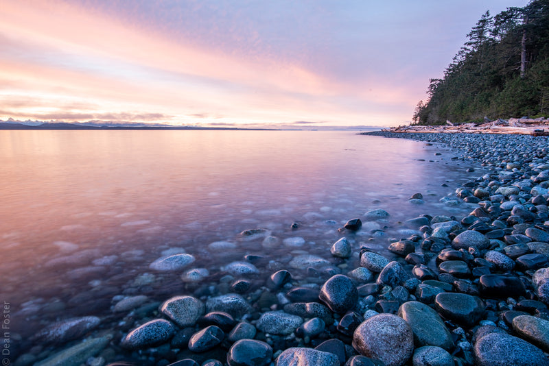 Sunrise reflects along rocky shore of Rebecca Spit, Quadra Island, landscape photography