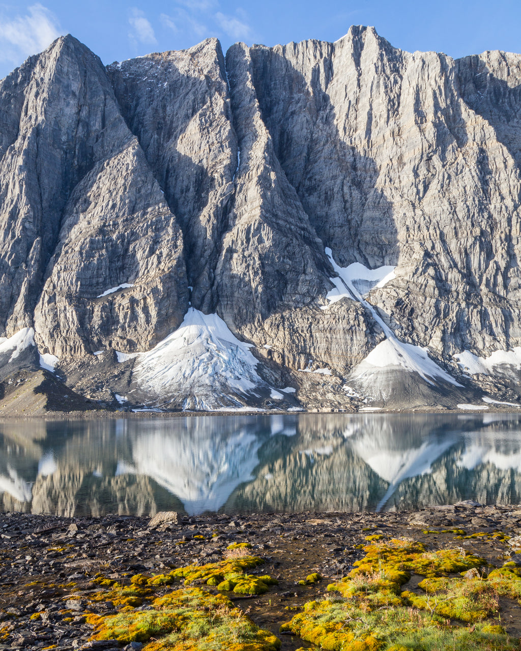 Rockwall reflecting in Floe Lake in Kootenay National Park, British Columbia.
