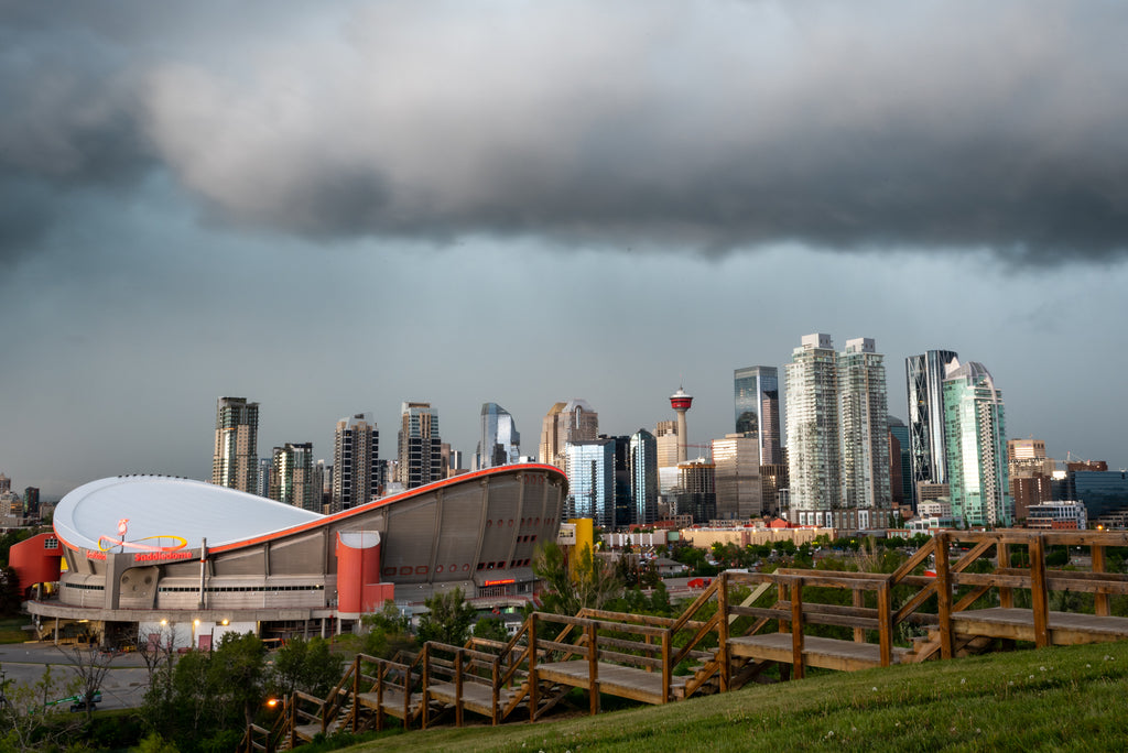 Saddledome, Calgary Tower and downtown Calgary underneath severe thunderstorm
