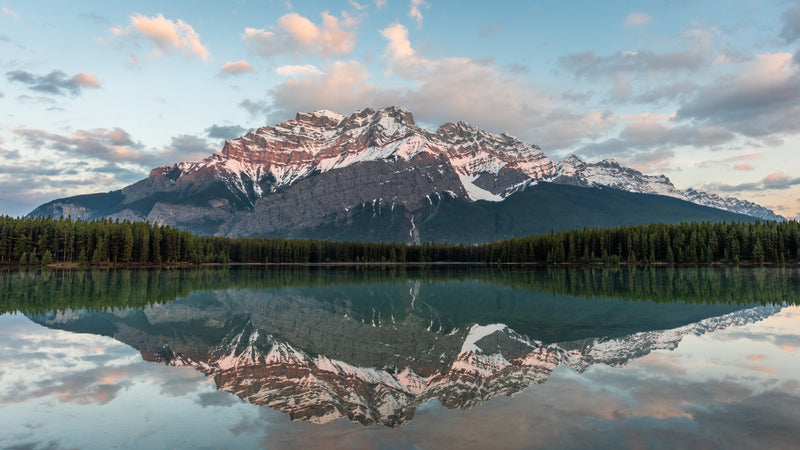 Cascade Mountain reflects in Two Jack Lake at Sunrise in Banff National Park, Alberta.