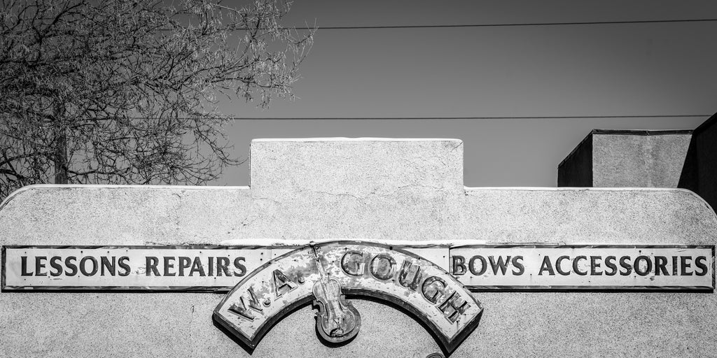 WA Gough Violin shop sign, black and white, historic building
