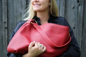 The Kerry Noël Genuine Leather Hobo Handbag is soft and durable enough to carry every day! This brightly colored red hobo is available on kerrynoel.com