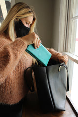 Customize your leather tote by Kerry Noël with pockets to fit your wallet!