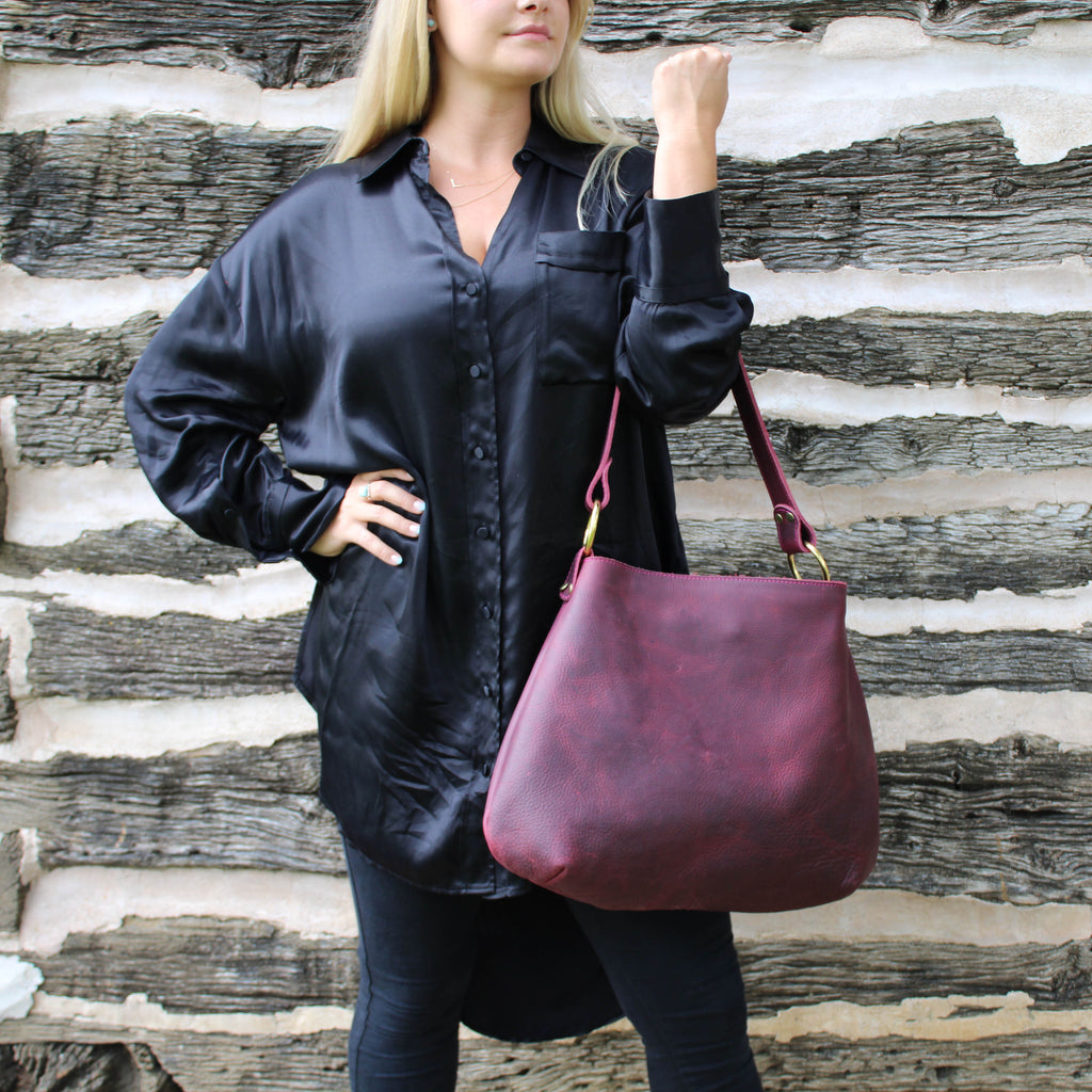 The Burgundy luxury leather hobo by Kerry Noël matches perfectly with our perfect turquoise trifold wallet!