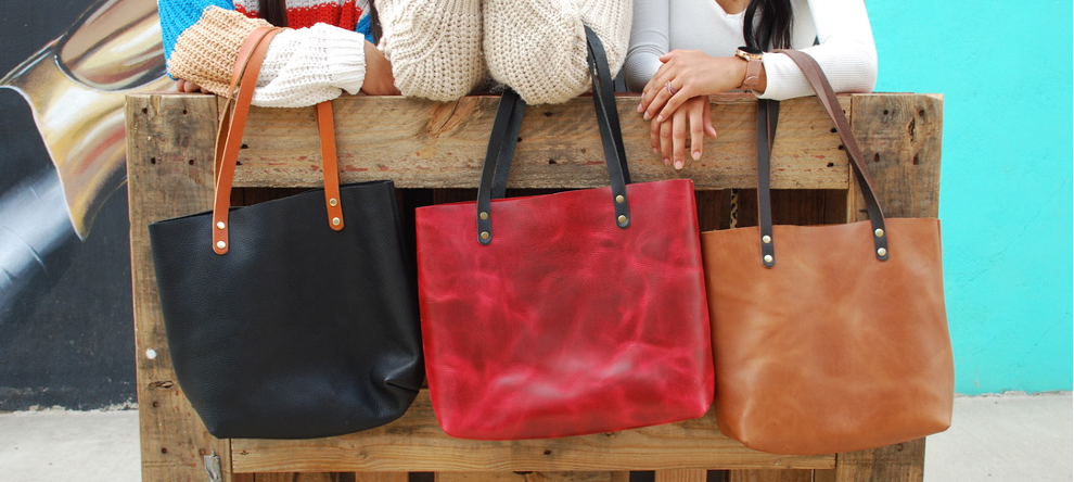 All of our genuine leather large totes come in a variety of colors including the dark brown leather tote bag, tan leather tote, and navy leather tote!