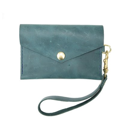 Closed View of Kerry Noël snap closure wallet with leather credit card case wallet capacity in blue distressed.