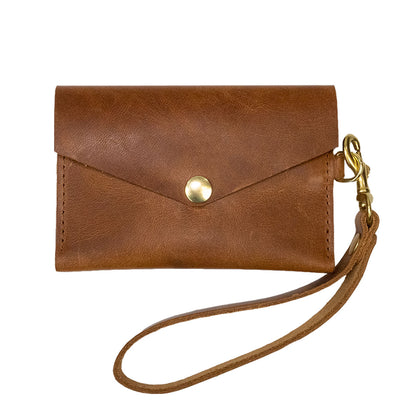 Closed View of Kerry Noël snap closure wallet with leather card case wallet womens capacity in English.