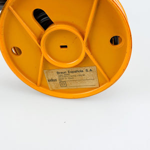 Braun KSM2 grinder designed by Hartwig Kahlcke in 1979. Yellow