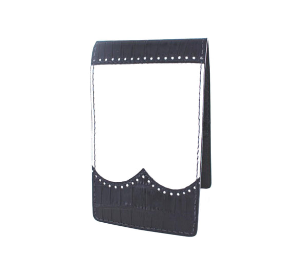 white leather yardage book cover with black alligator wingtips
