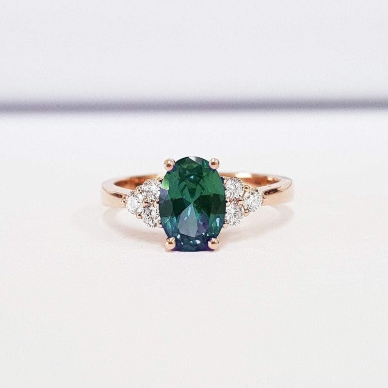 Emerald Oval Cut With Diamond Side Stones Rose Gold Ring