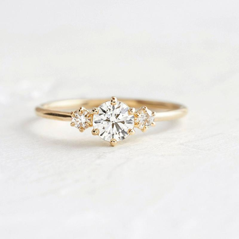 Moissanite 3-Stone Round Cut Yellow Gold Ring