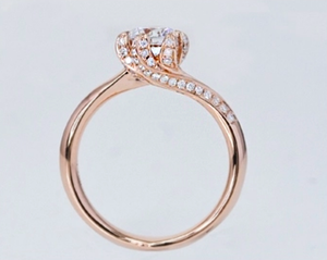 Diamond Round Brilliant Cut Solitaire with Side Stones Rose Gold Ring