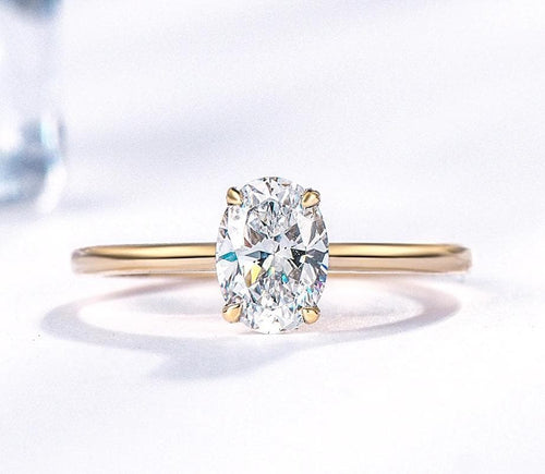 Moissanite Oval Cut Solitaire Yellow Gold Ring